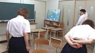 Two Japanese school girl spitting on teacher