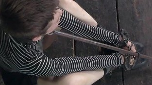Restrained sub spanked with cat o nine tails