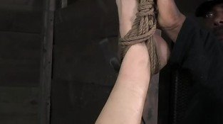 Tattood tied up sub paddled on pussy