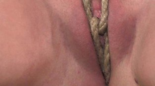 G string tied submissive and nipples clamped