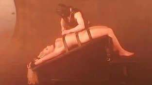 Hot candle wax on female slave tits and pussy