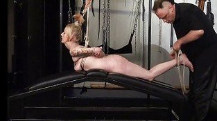 Blonde subbie in suspension bondage