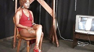 Bondaged ebony moaning while dominated
