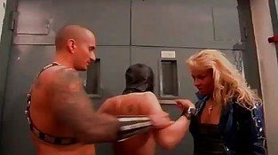 Blond slut in latex gets her boobs