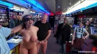 Bound busty babe anal fucked in porn store