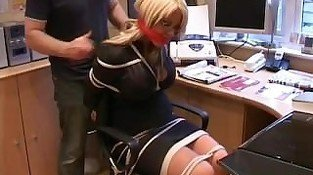 Secretary tied up at the office