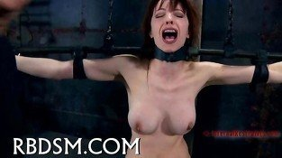 Caged up babe gets pleasuring clip