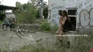 Brunette slim babe hanged in ropes outdoor from a bridge gets humiliated in public rough sex video