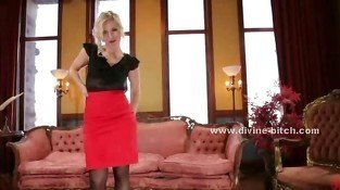 Mistress in red skirt and black shirt takes down clothes leaving black stocking naked