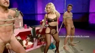 Blonde diva in stockings teaches pair of male slaves how to please her in nasty perversions