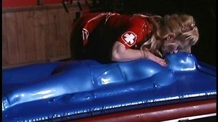 Blond Mistress covers slut in blue latex