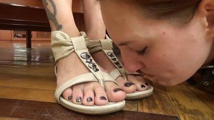 Lesbian slave licks feet and shoes
