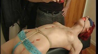 Small tits redhead enjoys hot wax over her body