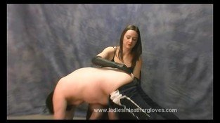 Hot dominant mistress gives slave dog leather glove spanking