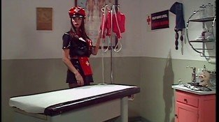 Latex-clad nurse with huge juggs self-administering cleaning and masturbating