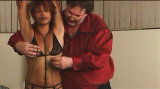 Hot BDSM couple binding and spanking