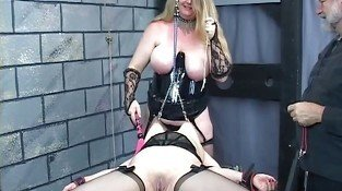Lesbian torture victim with shaved pussy is subjected to clamp play